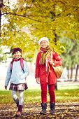 Portrait of two schoolgirls going home after school