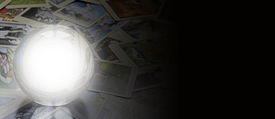 picture of oracle  - Crystal ball with empty center laid on random scattered tarot cards fading into black on the right side forming a website banner - JPG