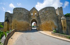 stock photo of domme  - The gate of the old picturesque small city of Domme in the Dordogne river area - JPG