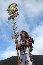 stock photo of spqr  - A Roman standard bearer inspires the men for battle  - JPG