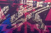 Reflection Of The City In Colored Plastic With Raindrops