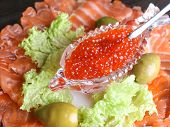 Red Caviar In A Crystal Bowl With Salmon And Green Salad