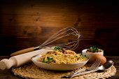stock photo of carbonara  - Delicious spaghetti with bacon and egg called alla carbonara on wooden table - JPG