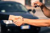 picture of rental agreement  - buyer and seller get to an agreement for a car sales - JPG