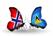 Two Butterflies With Flags On Wings As Symbol Of Relations Norway And Saint Lucia