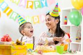 child and his mom have fun on birthday
