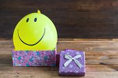 Yellow Balloon With Smile And Gift Box