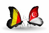 Two Butterflies With Flags On Wings As Symbol Of Relations Belgium And Singapore