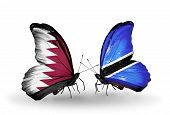 Two Butterflies With Flags On Wings As Symbol Of Relations Qatar And Botswana