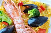 Spanish seafood paella with king prawn and mussels