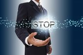 Businessman hand showing stop