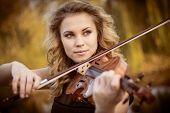 foto of violin  - Young woman playing the violin at park - JPG