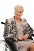 Smiling old woman in her wheelchair