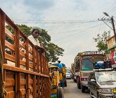 Thanjavour, India - February 13: An Unidentified Indian Man Stands In The Truck At The Traffic Conge
