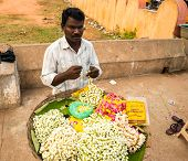 Thanjavour, India - February 13: An Unidentified Man Makes A Garland Of Flowers. India, Tamil Nadu,