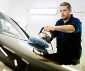 foto of luxury cars  - Man on a car wash polishing car with a polish machine  - JPG
