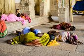 Madurai, India - February 16: An Unidentified Pilgrims And Child Are Resting In The Ancient Brihadis