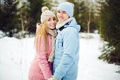 Young couple in winterwear having date in park
