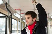 Young Man Traveling Alone By Public Transport