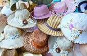 A pile of different handmade hats for sale in a shop at Pinnawala elephant orphanage