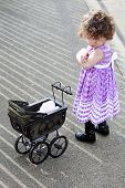 Little Girl With Vintage Stroller Looking Upset