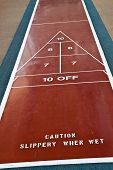 Caution On Shuffleboard Court
