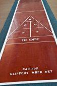 Caution On Shuffleboard Court