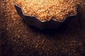 Christmas Golden  Food Background With Copy Space. Shiny Brown Sugar On Wooden Background Close Up,