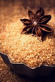 Christmas Food Background With Free Copyspace For Greeting Text. Star Anise And  Brown Cane Sugar On