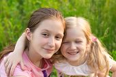 stock photo of sisters  - two smiling sisters - JPG