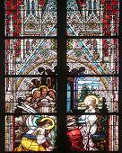 VIENNA, AUSTRIA - OCTOBER 11: Saint Cecilia, stained glass in Minoriten kirche in Vienna, Austria on October 11, 2014.
