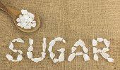 White Crystalline Sugar Arrange As Word Sugar  On Brown