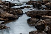 Fast Mountain River Flowing Among Stones