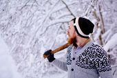 Lumberjack in the snowy winter forest
