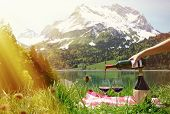 Wine served at a picnic in Alpine meadow. Switzerland