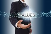 Businessman hand showing values button