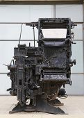 An old printing press machine being exhibited in the entrance of the Journalistic Center in Tel Aviv