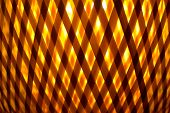 stock photo of cross-hatch  - abstract yellow orange background of cross lines - JPG
