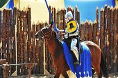picture of knights  - armored medieval knight on horseback at jousting competition - JPG