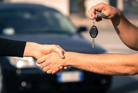 stock photo of rental agreement  - buyer and seller get to an agreement for a car sales - JPG