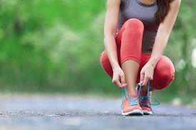 pic of crossed legs  - Running shoes  - JPG