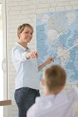 pic of geography  - Teacher in classroom teaching geography to pupils - JPG