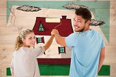 picture of stripping women window  - Young couple painting with roller against bleached wooden planks background - JPG