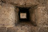 stock photo of slit  - the slit in the stone wall with the prospect - JPG