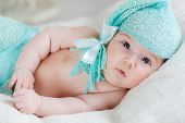 image of knitted cap  - Newborn baby with chubby cheeks - JPG