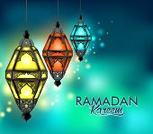 pic of kareem  - Beautiful Elegant Ramadan Kareem Lantern or Fanous Hanging With Colorful Lights in Night Background for the Holy Month Occasion of fasting - JPG