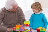 pic of brick block  - Image of grandfather and grandson playing bricks - JPG