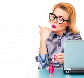 foto of finger-painting  - Business woman having a manicure and painting her nails on work isolated on white - JPG