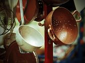 picture of flea  - ancient copper colander in cart for sale at flea market  - JPG