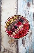 picture of berries  - Breakfast berry smoothie bowl topped with goji berries - JPG